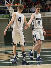 Adena's Logan Bennett high-fives teammate Jarrett Garrison during a 53-40 win over Chesapeake in a Division III district final game at Ohio University's Convocation Center in Athens, Ohio, on March 9, 2019.