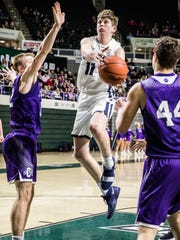 Logan Bennett drives to the rim in a 53-40 district final win over Chesapeake on March 9, 2019. Adena High School finished in second place in the Scioto Valley Conference in football, basketball, and baseball during the last school year. Now, they look to make their field of dreams a reality and finish first in the SVC.
