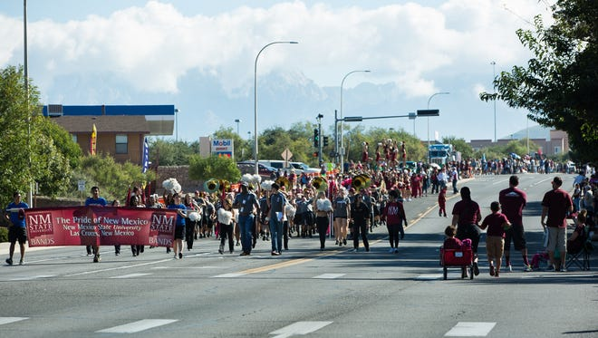 NMSU's Pride of New Mexico Marching Band makes its way down University Ave. along with other floats on Saturday, October 1, 2016, during the NMSU Homecoming Parade.