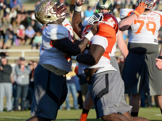 Florida State offensive guard Tre Jackson practices with the South Team