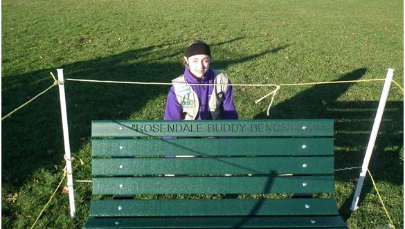 Caitlin Slonecker, of Rosendale, poses with her new Buddy Bench.