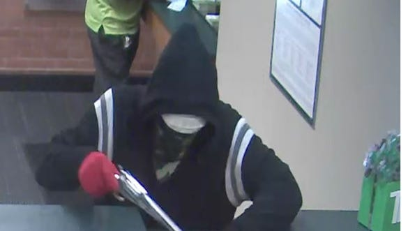 Police say this unknown white male robbed a Winooski TD Bank at gunpoint on Thursday, Aug 18