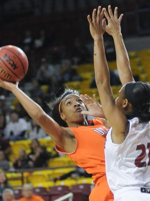 UTEP's Jenzel Nash take a shot with being guarded by NMSU player Tamera William at the Pan American Center on Saturday.