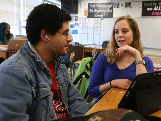 Des Moines North senior Carlos Ostorga gets some debate coaching from Becky Hall during a practice at North High School in Des Moines on Jan. 27.