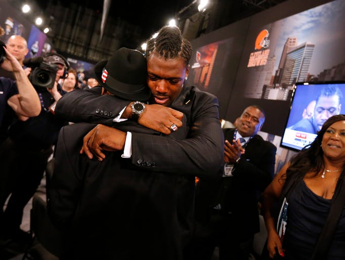 Jadeveon Clowney, from South Carolina, is congratulated after being selected number one overall by the Houston Texans in the first round of the NFL football draft, Thursday, May 8, 2014, at Radio City Music Hall in New York. (AP Photo/Jason DeCrow)