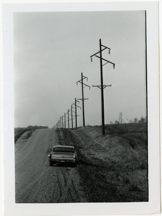 636241274950364447-0307-Stearns-Electric---Poles-into-distance.jpg