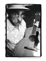 Blues guitarist and singer-songwriter Roy Book Binder