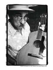Blues guitarist and singer-songwriter Roy Book Binder
