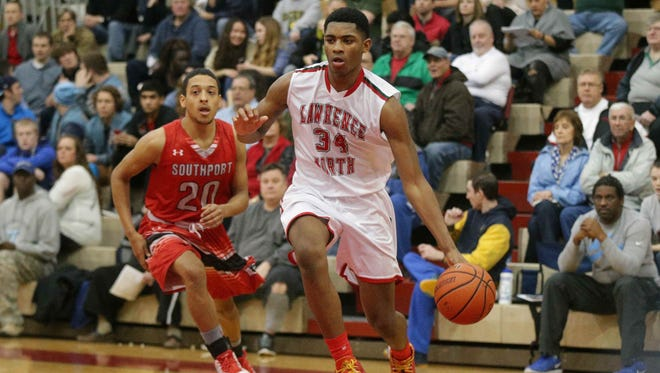 Lawrence North High School sophomore Kevin Easley Jr., shown driving against Southport's David Reyes during a Marion County Boys Basketball Tournament semifinal, is learning a new position and still adjusting to life without his mom.