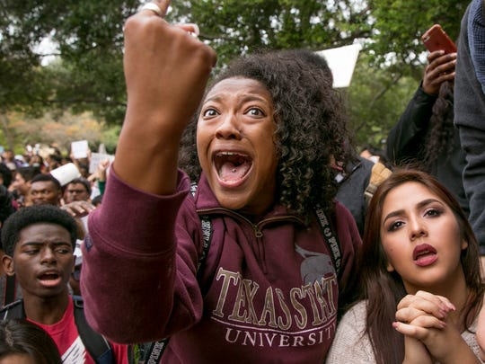 """In this Thursday Nov. 10, 2016 photo, Arielle Moore, 19, argues with a Trump supporter, not pictured, during a protest at Texas State University in San Marcos, Texas, after Donald Trump's presidential election victory. Nearly 2,000 teachers surveyed by the Southern Poverty Law Center in the spring of 2016 reported that the campaign's scorching words were having a """"profoundly negative impact"""" on their students. More than half said they had seen an increase in bullying, harassment and intimidation of students whose race, religion or nationality had been targeted by political rhetoric."""