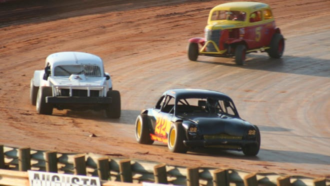Ruckersville's Dale Payton in his 1950 Ford Coupe leads Mike Nickle of Louisa County and Jeffrey Stammle of Lake Lynn, Pa., in Vintage Stock Car Race at Eastside Speedway on Saturday night.
