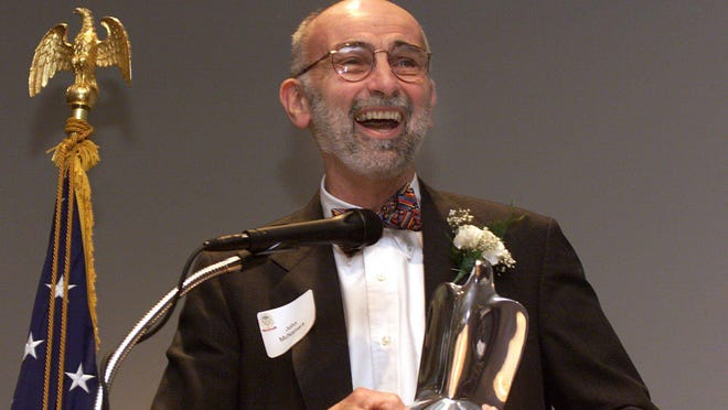 John McNamara accepts the 2000 Distinguished Citizens Award on May 10, 2000, given by the Blackhawk Area Council Boys Scouts of America at Giovanni's Restaurant in Rockford.