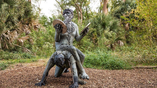 "Nicole Eisenman's 2019 ""Man at the Center of Men,"" made of bronze and stainless steel and staged in a glade away from the water's edge, is new to Laguna Gloria."