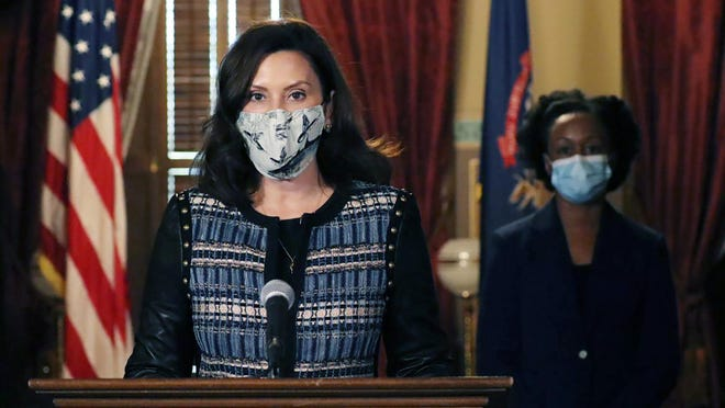 In a photo provided by the Michigan Office of the Governor, Gov. Gretchen Whitmer addresses the state during a speech in Lansing, Mich., Thursday, Nov. 5, 2020. The governor said she sent a letter to Republican lawmakers this week asking them to pass a bill to require residents wear masks in indoor places and crowded outdoor areas.