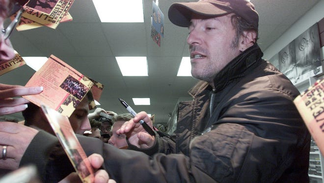 Jack's Music Shoppe in Red Bank has attracted a lot of customers over the decades, including Bruce Springsteen. Springsteen is seen here when he made a surprise appearance at Jack's in this 2001 file photo.