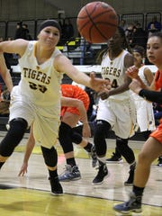 Alamogordo's Daniella Martinez reaches out to grab a rebound Friday night.