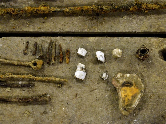 Nails, pieces of pipe, broken ceramic and an oyster shell are among the items found by York Suburban rising junior Alan Countess, 16, and York College adjunct professor and anthropologist Ben Luley in the basement of the former Northern Central Railroad Passenger Depot as of Wednesday, June 10, 2015. Because of the shallowness of the surface soil, Luley doesn't anticipate finding much beyond the glass fragments, coins, nails and other odds and ends they have already found.