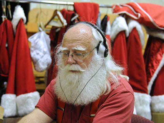 Santa Claus listens to the Vienna Boys Choir duirng a lunch break at the York Galleria Mall on Thursday, Dec. 5, 2013. Santa, whose known as Richard Meadow in the off season is at the mall daily throughout the holiday season.  Jason Plotkin -  Daily Record/Sunday News