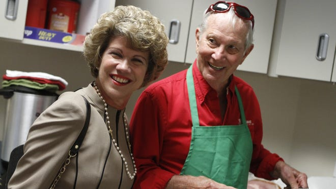 Clarksville Mayor Kim McMillan visits Leaf-Chronicle Publisher Emeritus Gene Washer in the kitchen during the Country Ham Breakfast on Tuesday morning.
