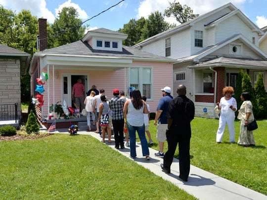 A line of people wait to take a tour of the Childhood home of Muhammad Ali, Sunday, Jun. 05, 2016 in Louisville Ky.