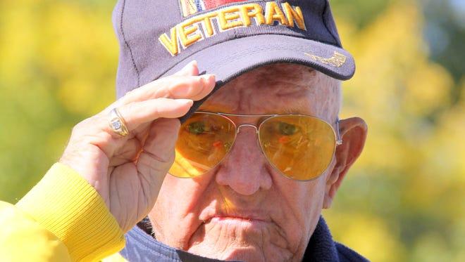 Irv Rutto, a U.S. Navy veterans of World War II, salutes.