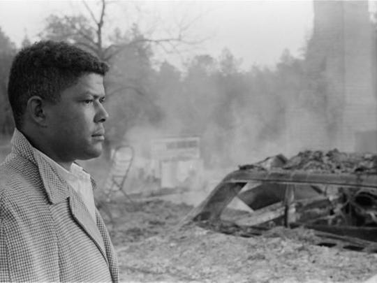 Harold Dahmer, the 26-year-old son of Vernon Dahmer Sr., stands outside the family home after the Ku Klux Klan attack that killed his father on Jan. 10, 1966.