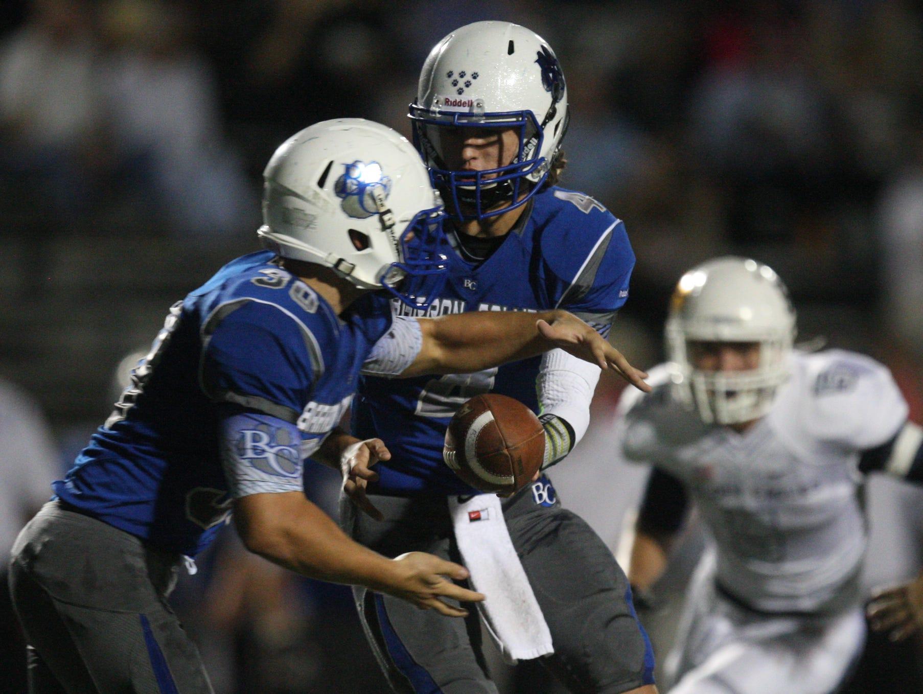 Action between Naples High School and Barron Collier on Friday at Barron Collier High School in Naples. Naples beat Barron Collier 48-14.