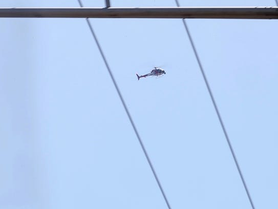 A helicopter flies over the Port of Wilmington Wednesday,