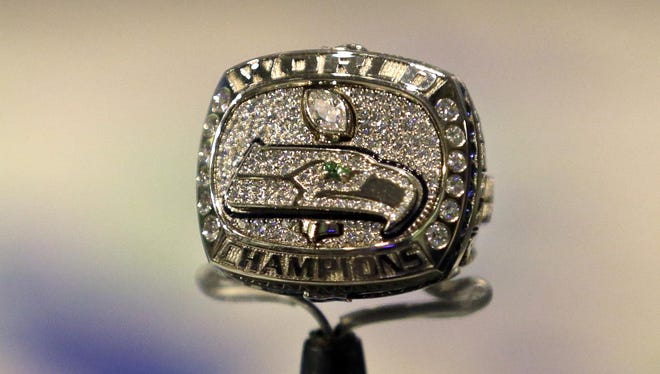 A Seattle Seahawks Super Bowl ring is displayed at the EMP Museum in Seattle in 2014.