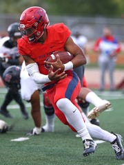 Dixie State QB Malik Watson carries the ball during a game against Central Washington on Sept. 23, 2017