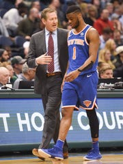 New York Knicks head coach Jeff Hornacek talks to guard