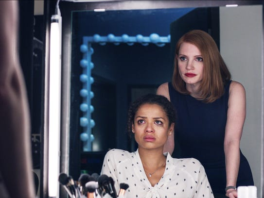 Gugu Mbatha-Raw (seated) and Jessica Chastain in 'Miss