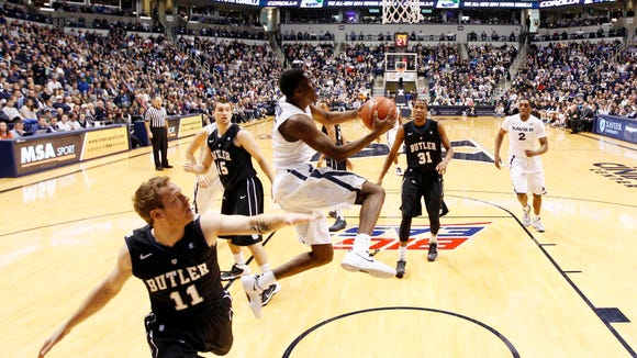 Jan 4, 2014; Cincinnati, OH, USA; Xavier Musketeers guard Semaj Christon (0) shoots during the first half against the Butler Bulldogs at the Cintas Center. Xavier defeated Butler 79-68.
