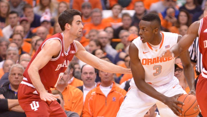 Syracuse Orange forward Jerami Grant (3) dribbles the ball as Indiana Hoosiers guard Will Sheehey (0) defends during the first half of a game at the Carrier Dome.