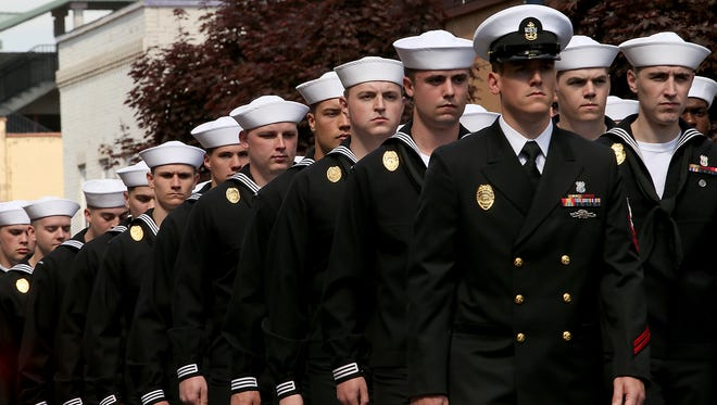 Navy sailors march down 4th Street during the Armed Forces Day Parade in Bremerton on Saturday, May 20, 2017.