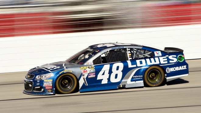 NASCAR Sprint Cup Series driver Jimmie Johnson (48) races during the Folds of Honor QuikTrip 500 at Atlanta Motor Speedway.