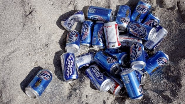 A pile of beer cans lays in the sand during spring break in South Beach, Miami Beach, Florida, March 16, 2007.