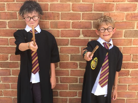 Hyden Griffin, 8, and his brother, 7-year-old Sam Griffin from Staunton spent the day rediscovering downtown Staunton dressed as Harry Potter.