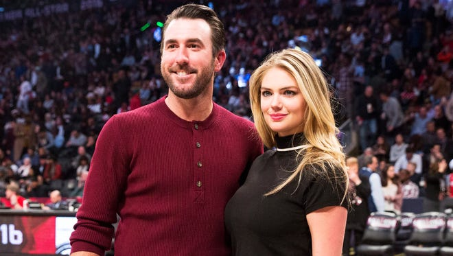 Detroit Tigers pitcher Justin Verlander, left, and model Kate Upton pose for a photograph during second half NBA All-Star Game basketball action in Toronto on Sunday, Feb. 14, 2016.