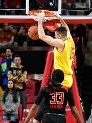 Maryland Terrapins center Michal Cekovsky (15) dunks