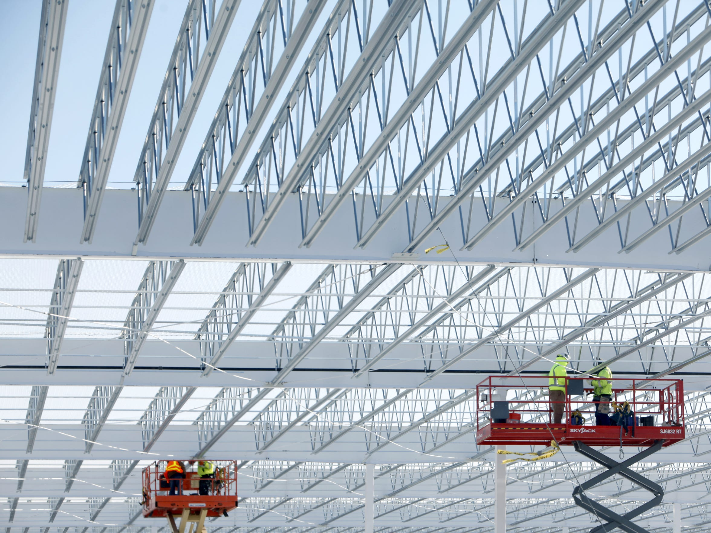 Workers at the Costco building under construction at