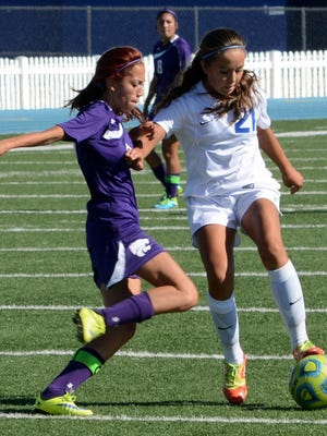 Carlsbad freshman midfielder Gabby Aragon keeps the ball away from Clovis junior midfielder Dani Rodriguez in the first half Saturday, Sept. 26. Aragon and four other Cavegirls were named all-state honorable mentions this week.