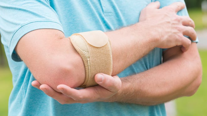 Tennis elbow occurs when the tendons in the elbow get stretched beyond their capacity by a repetitive action and become inflamed.