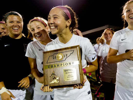 Bearden's Kendall Scott (18) holds the plaque after