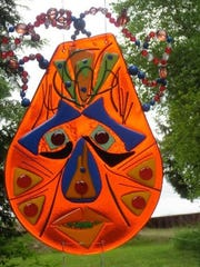 Glass mobile by Penelope Brown, part of the Lily Bay Lakeshore Artisans art crawl from July 21 to 23.
