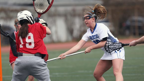 Bronxville's Allie Berkery (18) puts a s shot past