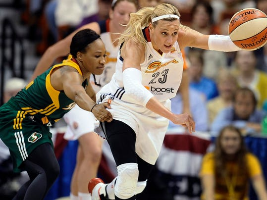 Connecticut Sun's Katie Douglas, right, steals the ball from Seattle Storm's Temeka Johnson during the first half of a WNBA basketball game, Friday, May 23, 2014, in Uncasville, Conn. (AP Photo/Jessica Hill)