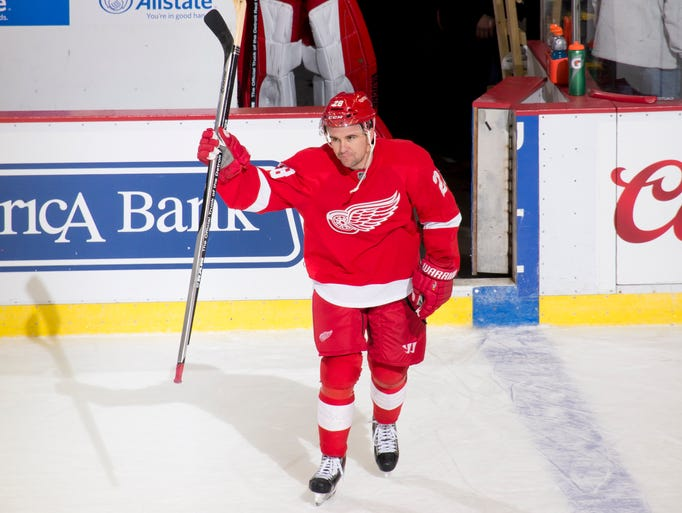 Detroit defenseman Marek Zidlicky waves to the crowd
