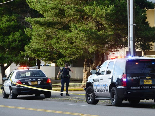 Salem Police respond to an incident at an apartment complex at Broadway and Locust in NE Salem on Friday, July 4, 2014.