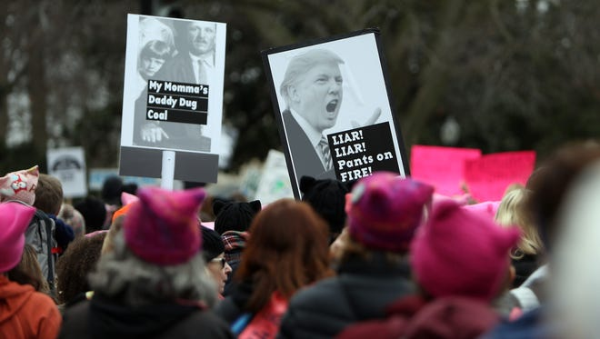 Women's March protests flooded public spaces in hundreds of cities across the US. The size of the Women's March on Washington, surprised even to organizers, estimates ranging from 500,000 to 1 million attendees, so many that the march itself became impractical and was converted to a rally. January 21, 2017, Washington DC.